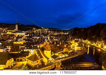 Aerial view of old Town of Cesky Krumlov, Czech Republic at dusk