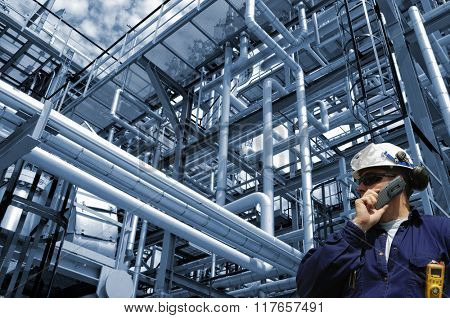 oil and gas worker, pipelines and refinery, blue toning background