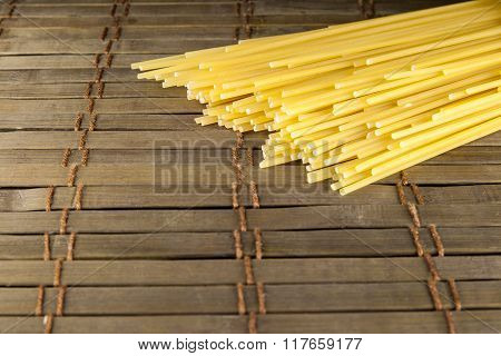 Bunch Of Spaghetti On Wooden Table Background