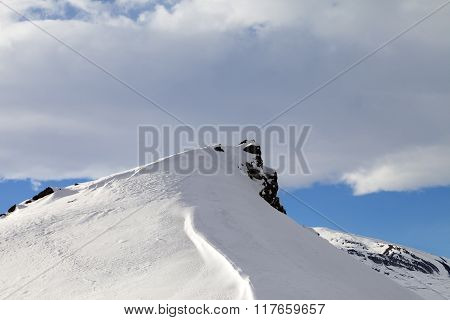 Top Of Mountains With Snow Cornice After Snowfall