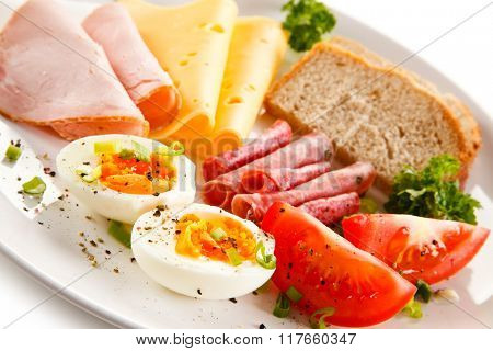 Breakfast - boiled egg, ham, cheese and vegetables