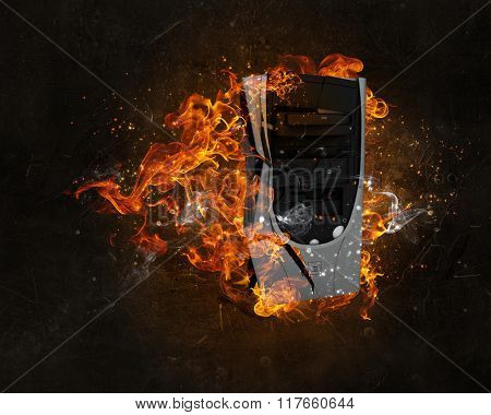 Computer burning with fire