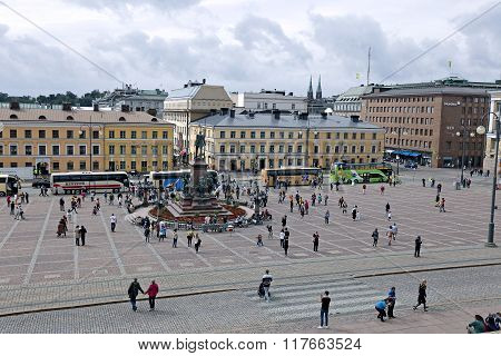 Many Tourists And Tour Buses Around The Monument To Russian Emperor Alexander Ii On The Senate Squar