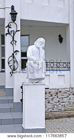 Statue Of Monk With Key Sitting In Raif Monastery