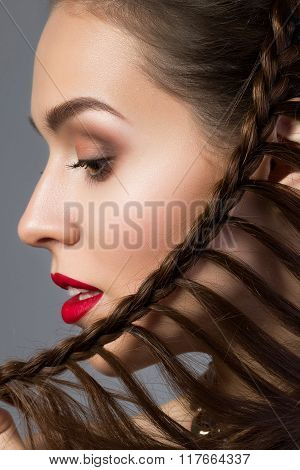 Close-up Beauty Portrait Of Young Aristocratic Woman With Red