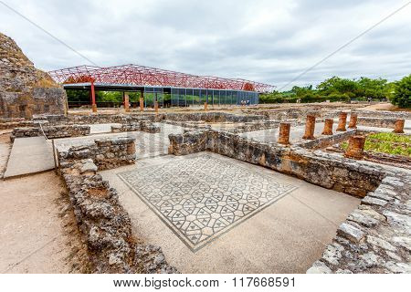 Roman ruins of Conimbriga. The Swastika Domus, and structure protecting the Fountains Domus in the back. Conimbriga, in Portugal, is one of the best preserved Roman cities on the west of the empire.