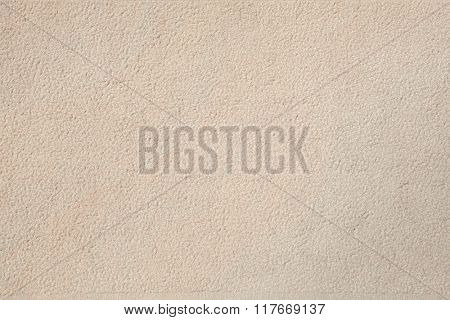 Beige stone wall. Background texture.
