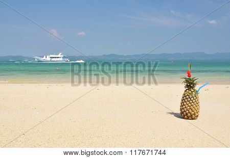 Pineapple cocktail on a tropical beach