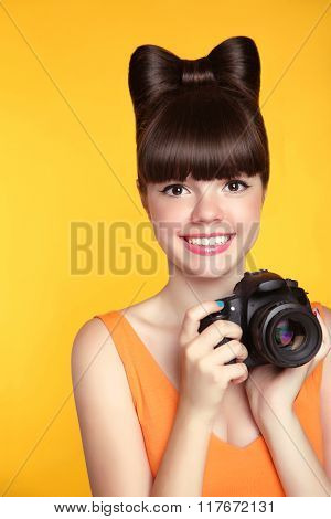 Beautiful Smiling Teen Girl Taking A Photo. Pretty Model Is A Professional Photographer With Camera