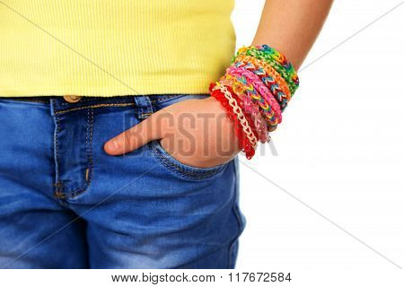 Hand in pocket teen girl with trendy handmade weaving bracelets