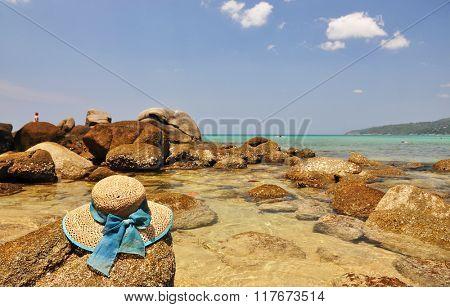 Straw hat on the rock. Phuket island, Thailand