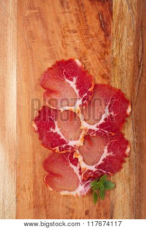 antipasti Platter of Cured Meat  jamon and wooden background , closeup