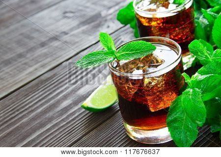 Cocktail With Cola, Lime And Mint