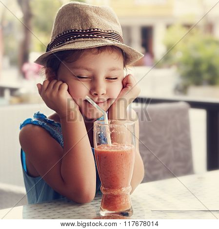 Fun Kid Girl In Hat Screwing Up Her Eyes And Waiting The Moment To Drink The Smoothie Tasty Juice. T