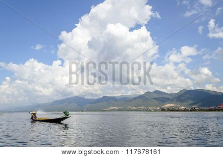 INLE LAKE, MYANMAR - NOVEMBER 02: Farmer carrying paddy go home on a small boat. on November 2, 2015 on Inle Lake, Myanmar (BURMA). Many homes in the area can only be reached by boat.