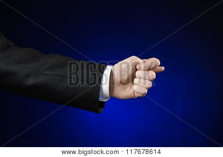 Businessman And Gesture Topic: A Man In A Black Suit And White Shirt Showing Hand Gesture On An Isol