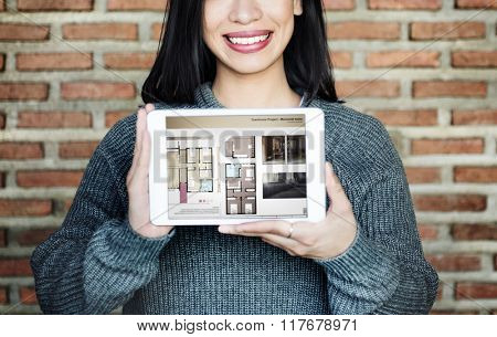 Asian Lady Showing Floor Plan on Tablet Concept