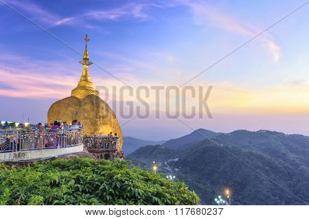Golden rock, Kyaikhtiyo or Kyaiktiyo pagoda in twilight time crowded with unidentified tourists