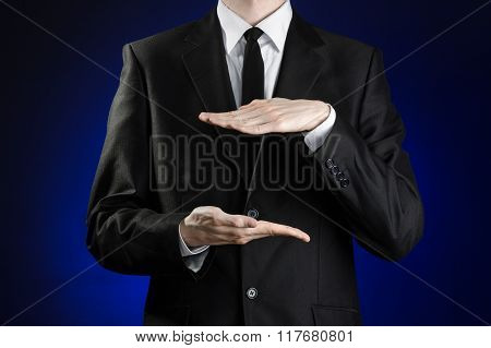 Businessman And Gesture Topic: A Man In A Black Suit And White Shirt Showing Gestures With Hands On