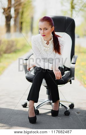 Beautiful Girl Sitting On The Chair