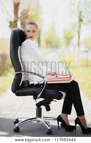 Beautiful Girl Standing At The Chair