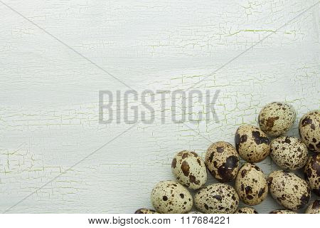 Quail eggs cracked on a white background