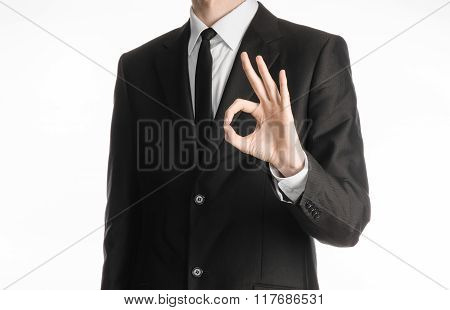 Businessman And Gesture Topic: A Man In A Black Suit With A Tie Showing Okay Hand Gesture On An Isol