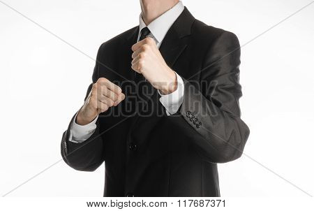 Businessman And Gesture Topic: A Man In A Black Suit Holding His Fists In Front Of Him, Business Str