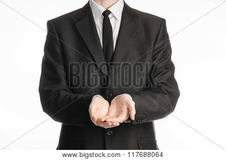 Businessman And Gesture Topic: A Man In A Black Suit With A Tie Folded His Hands In Front Of Him Iso