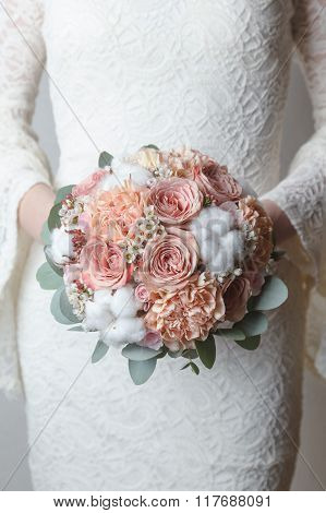 Pale terracotta wedding bouquet with cotton flowers