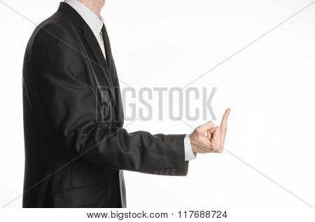 Businessman And Gesture Topic: A Man In A Black Suit Showing Middle Finger On An Isolated White Back