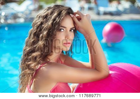 Beauty Fashion Girl Close Up Of Sexy Model With Pink Fitness Ball In Blue Swimming Pool On Summer Va