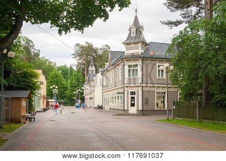 Pedestrians walk around Jomas Street in Jurmala, Latvia.