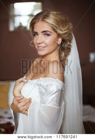 Beautiful Smiling Bride Wedding Portrait. Beauty Fashion Girl Posing On Camera At Home In Modern Int