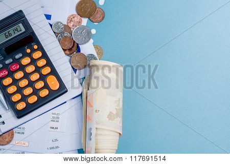Mortgage And Utility Bills, Coins And Roll Of Cash, Calculator, Copy Space