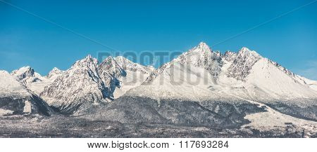 Mountain landscape, snow covered high mountains and blue sky