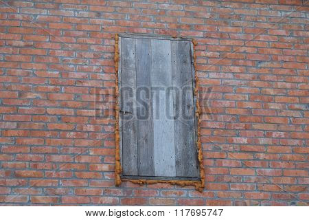 The wooden door of the attic. Detached house in the village.