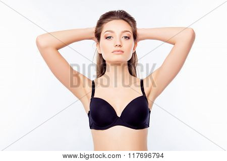 Young Sexy Woman Demonstrate Her Black Bra And Touching Hair