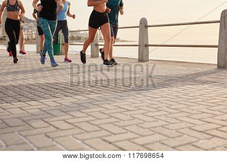 People Running On Street By The Sea