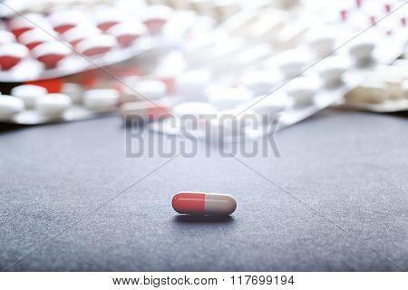 Single orange-white capsule.