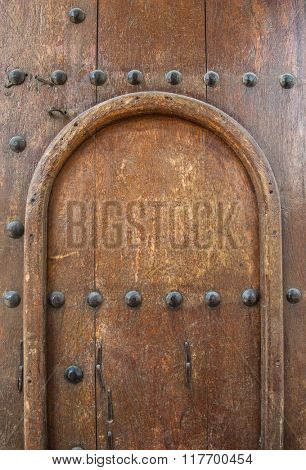 Closeup of antique  wooden door panel.
