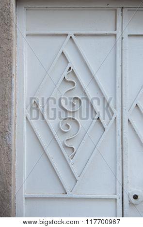 A decorative design on a metal door. Metal fabrication work.