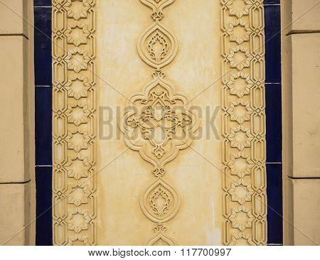 Decorative relief design on the wall. Islamic architectural details.