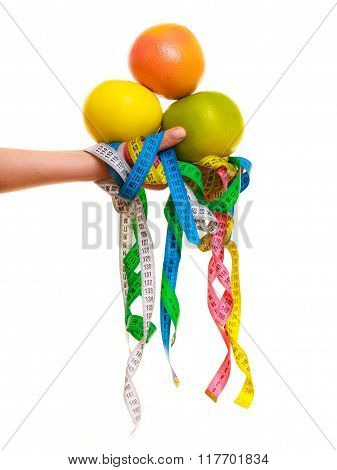 Diet. Colorful Measure Tapes And Citrus Fruits