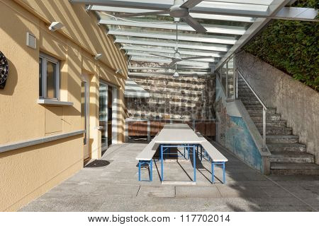 architecture, veranda with table and benches, outside