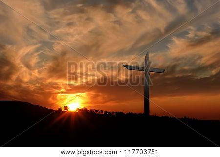 Christian Cross Over Sunset Background