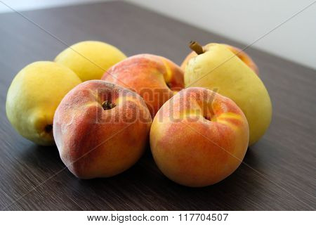 peaches and pears on the table