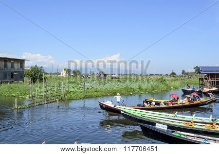 INLE LAKE, MYANMAR - NOVEMBER 02: Empty long tail boat with motor waiting for tourists and local people in village near Inle Lake on November 2, 2015 on Inle Lake, Myanmar (BURMA).