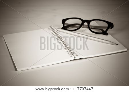 Notebook With A Pencil And Eye Glasses, Vintage Effect