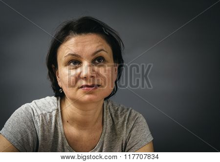 Portrait of a tired mature woman.